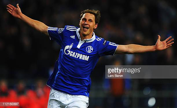 Benedikt Hoewedes of Schalke celebrates after scoring his teams second goal during the UEFA Champions League quarter final second leg match against...