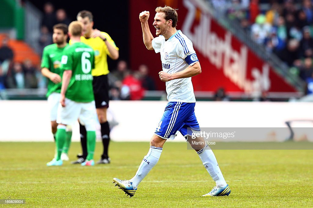 Benedikt Hoewedes of Schalke celebrates after the Bundesliga match between Werder Bremen and FC Schalke 04 at Weser Stadium on April 6, 2013 in Bremen, Germany.