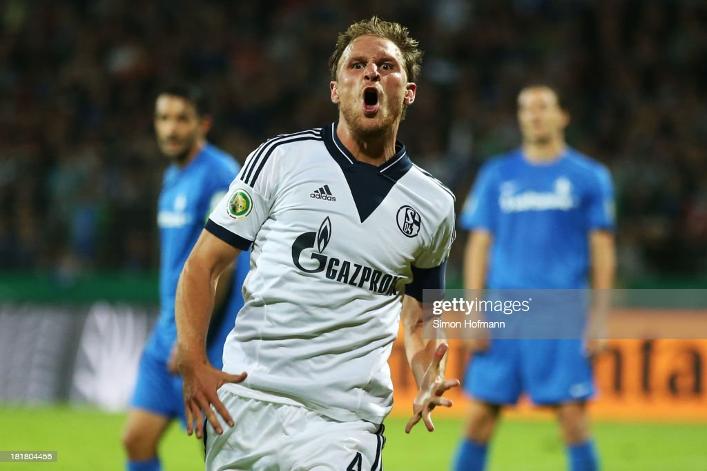 <a gi-track='captionPersonalityLinkClicked' href=/galleries/search?phrase=Benedikt+Hoewedes&family=editorial&specificpeople=3945465 ng-click='$event.stopPropagation()'>Benedikt Hoewedes</a> of Schalke celebrates his team's second goal during the DFB Cup second round match between Darmstadt 98 and Schalke 04 at Stadion am Boellenfalltor on September 25, 2013 in Darmstadt, Germany.