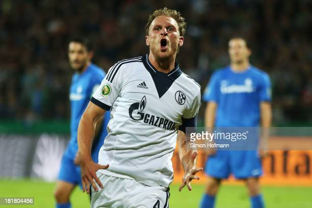 Benedikt Hoewedes of Schalke celebrates his team's second goal during the DFB Cup second round match between Darmstadt 98 and Schalke 04 at Stadion...