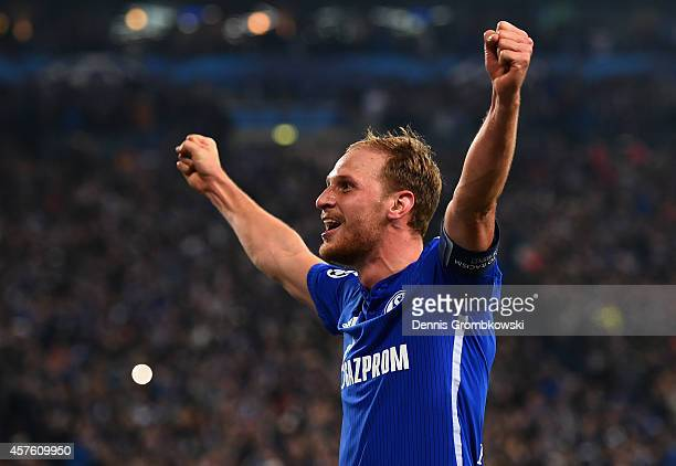 Benedikt Hoewedes of Schalke celebrates scoring their third goal during the UEFA Champions League Group G match between FC Schalke 04 and Sporting...