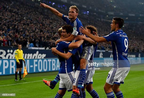 Benedikt Hoewedes of Schalke celebrates with team mates after scoring his teams first goal during the Bundesliga match between FC Schalke 04 and...