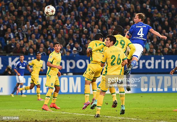 Benedikt Hoewedes of Schalke heads towards goal to score their third goal during the UEFA Champions League Group G match between FC Schalke 04 and...
