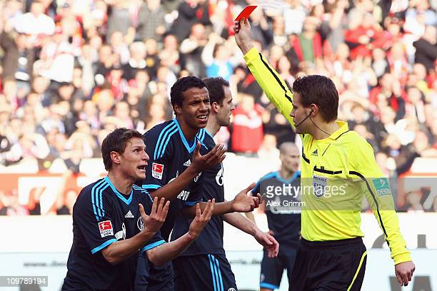 Benedikt Hoewedes of Schalke is sent off by referee Felix Brych during the Bundesliga match between VfB Stuttgart and FC Schalke 04 at MercedesBenz...