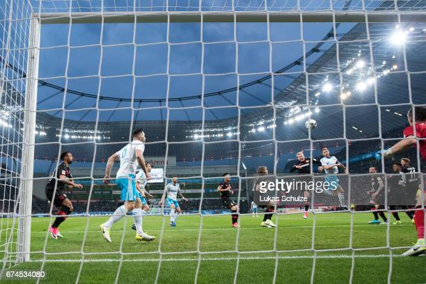 Benedikt Hoewedes of Schalke scores his teams second goal against Julian Brandt of Leverkusen during the Bundesliga match between Bayer 04 Leverkusen...