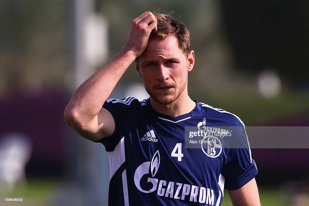 <a gi-track='captionPersonalityLinkClicked' href=/galleries/search?phrase=Benedikt+Hoewedes&family=editorial&specificpeople=3945465 ng-click='$event.stopPropagation()'>Benedikt Hoewedes</a> reacts during a Schalke 04 training session at the ASPIRE Academy for Sports Excellenc on January 4, 2013 in Doha, Qatar.