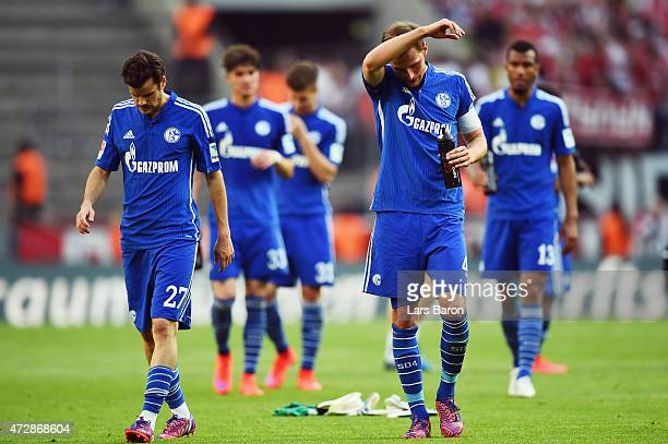 Benedikt Hoewedes Tranquillo Barnetta and team mates of Schalke react after the Bundesliga match between 1 FC Koeln and FC Schalke 04 at...