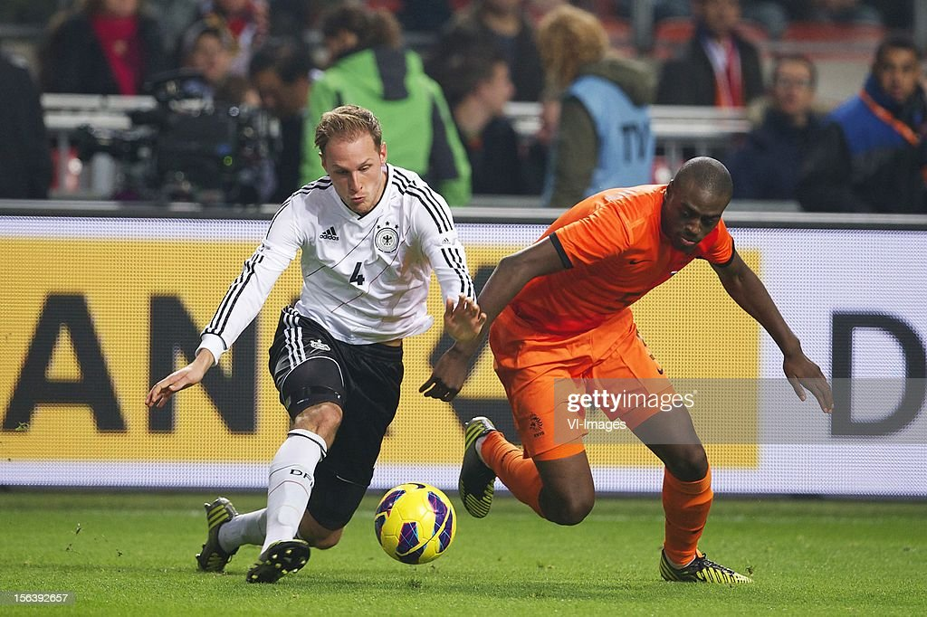 Benedikt Howedes of Germany, Bruno Martins Indi of Holland during the Friendly match between Holland and Germany at the Amsterdam Arena on November 14, 2012 in Amsterdam, The Netherlands.