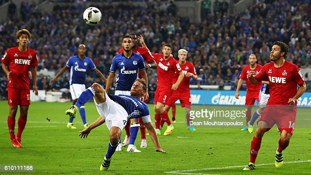 Benedikt Howedes of Schalke does an over head kick during the Bundesliga match between FC Schalke 04 and 1 FC Koeln at VeltinsArena on September 21...