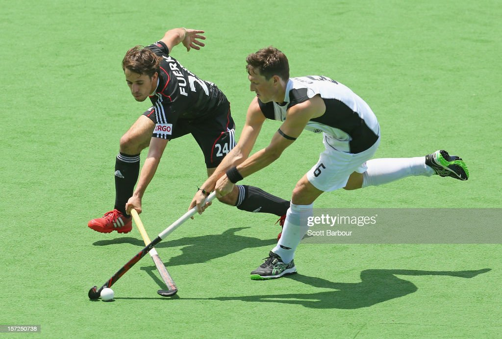 Benedikt Huerk of Germany and Simon Child of New Zealand compete for the ball during the match between Germany and New Zealand on day one of the Champions Trophy on December 1, 2012 in Melbourne, Australia.