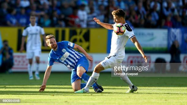Benedikt Koep of Mannheim challenges Thilo Leugners of Meppen during the Relegation Regionalliga Play Off second leg match at Hensch Arena on May 31...