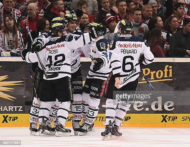 Benedikt Kohl of ERC Ingolstadt celebrates with team mates as he scores the opening goal during the DEL Ice Hockey game between Koelner Haie and ERC...