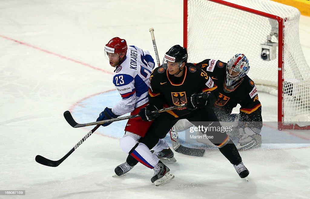 Benedikt Kohl (R) of Germany and Denis Kokarev (L) of Russia battle for positoin in front of the net during the IIHF World Championship group H match between Germany and Russia at Hartwall Areena on May 5, 2013 in Helsinki, Finland.