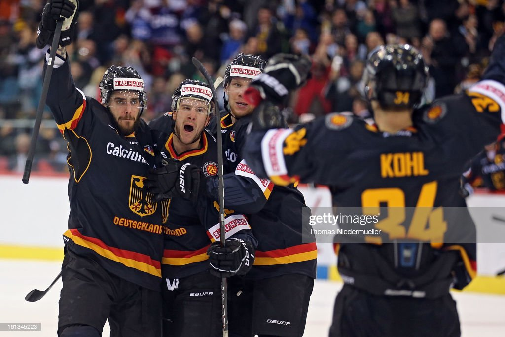 Benedikt Kohl (#34) of Germany celebrates his goal with his teammates during the Olympic Icehockey Qualifier match between Germany and Austria on February 10, 2013 in Bietigheim-Bissingen, Germany.