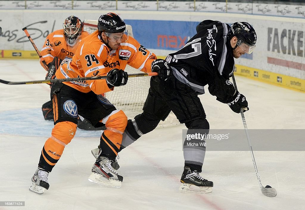Benedikt Kohl (L) of Wolfsburg challenges Patrick Reimer of Nuremberg during game three of the DEL pre-play-offs between Thomas Sabo Ice Tigers and Grizzly Adams Wolfsburg on March 17, 2013 in Nuremberg, Germany.