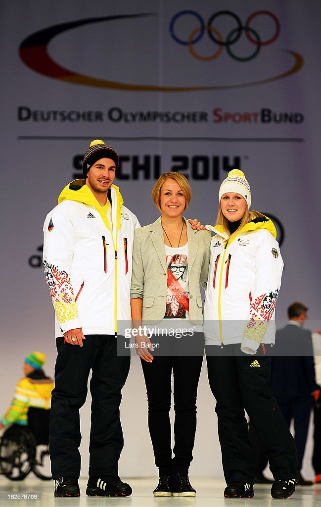 Benedikt Mayr, former Biathlon athlet <a gi-track='captionPersonalityLinkClicked' href=/galleries/search?phrase=Magdalena+Neuner&family=editorial&specificpeople=2095093 ng-click='$event.stopPropagation()'>Magdalena Neuner</a> and <a gi-track='captionPersonalityLinkClicked' href=/galleries/search?phrase=Andrea+Rothfuss&family=editorial&specificpeople=806259 ng-click='$event.stopPropagation()'>Andrea Rothfuss</a> pose during the German Olympic and Paralympic team kit presentation at Messe Duesseldorf on October 1, 2013 in Dusseldorf, Germany.