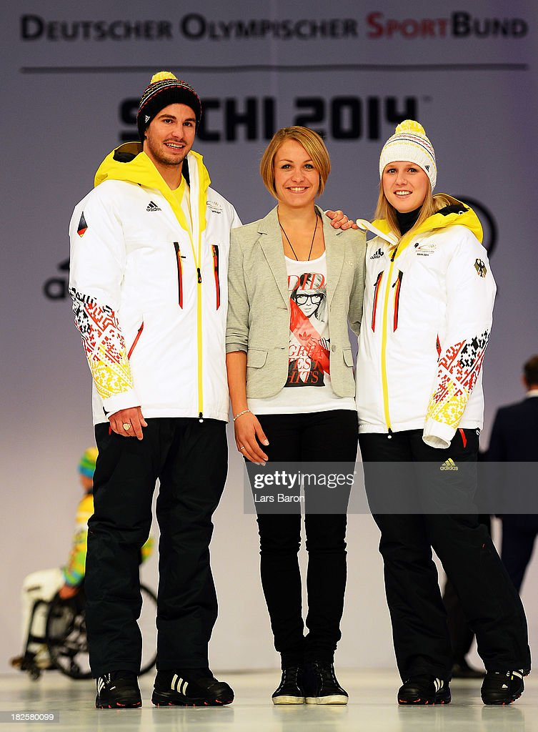 Benedikt Mayr, former Biathlon athlet Magdalena Neuner and Andrea Rothfuss pose during the German Olympic and Paralympic team kit presentation at Messe Duesseldorf on October 1, 2013 in Dusseldorf, Germany.