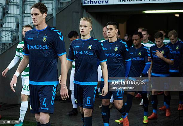 Benedikt Röcker of Brondby IF Hjötur Hermannsson of Brondby IF Svenn Crone of Brondby IF and teammates walk on to the pitch prior to the Danish Alka...