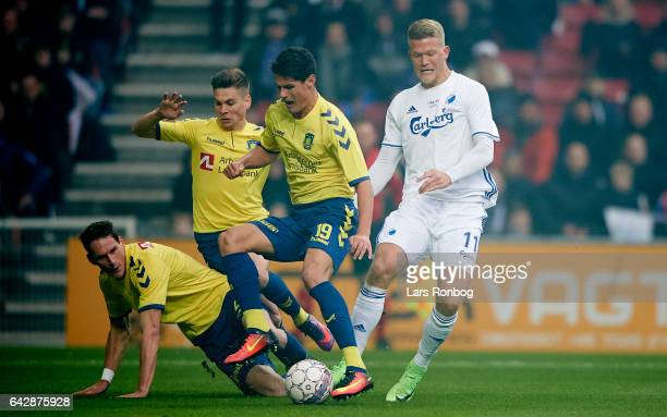 Benedikt Rocker Gregor Sikosek and Christian Norgaard of Brondby IF compete for the ball with Andreas Cornelius of FC Copenhagen during the Danish...