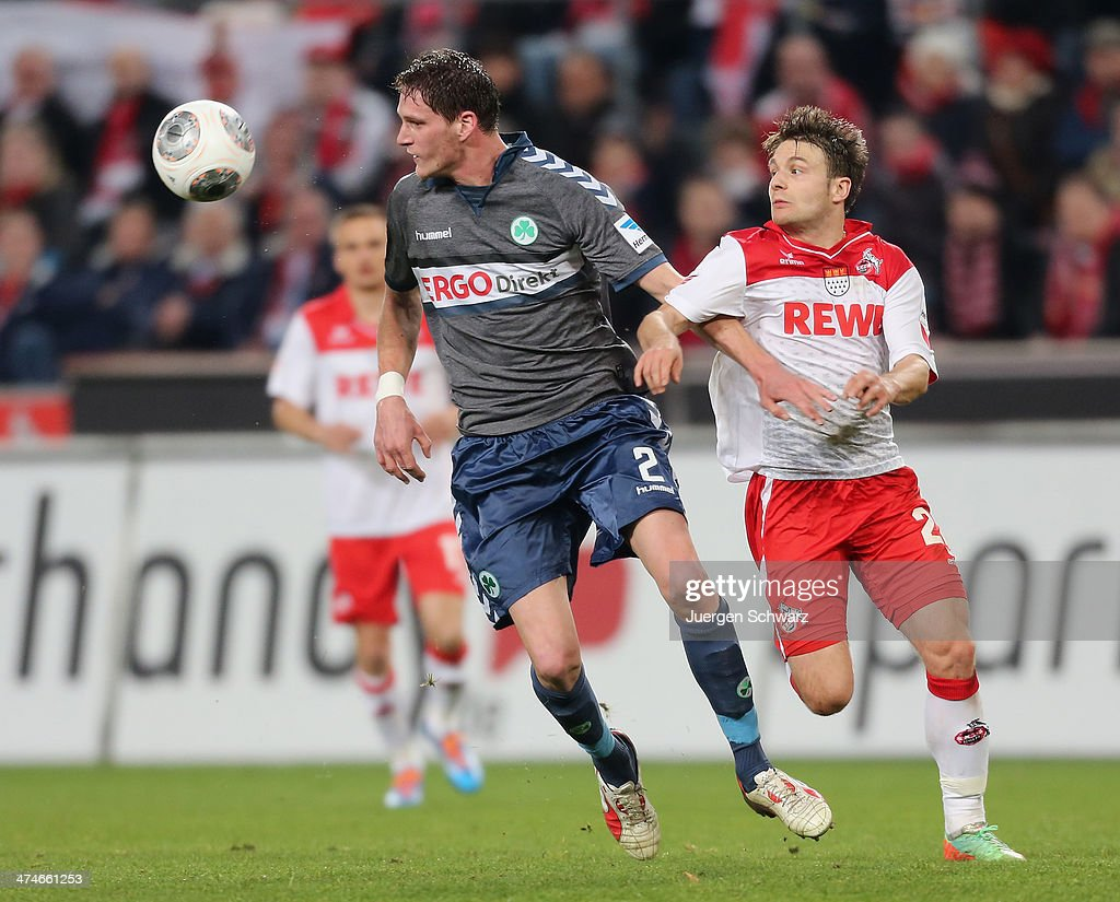 Benedikt Roecker of Fuehrt (L) and Daniel Halfar of Cologne fight for the ball during the 2nd Bundesliga match between 1. FC Koeln and Greuther Fuerth at RheinEnergieStadion on February 24, 2014 in Cologne, Germany.