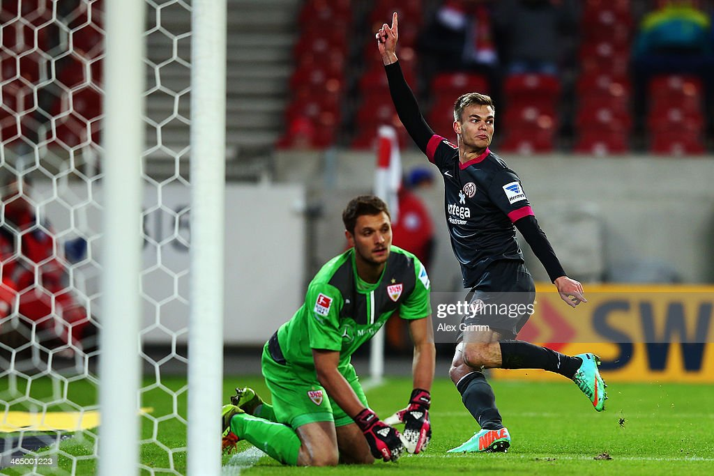 Benedikt Saller of Mainz celebrates his team's second goal as goalkeeper <a gi-track='captionPersonalityLinkClicked' href=/galleries/search?phrase=Sven+Ulreich&family=editorial&specificpeople=4877030 ng-click='$event.stopPropagation()'>Sven Ulreich</a> of Stuttgart reacts during the Bundesliga match between VfB Stuttgart and 1. FSV Mainz 05 at Mercedes-Benz Arena on January 25, 2014 in Stuttgart, Germany.