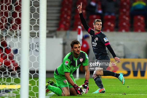 Benedikt Saller of Mainz celebrates his team's second goal as goalkeeper Sven Ulreich of Stuttgart reacts during the Bundesliga match between VfB...
