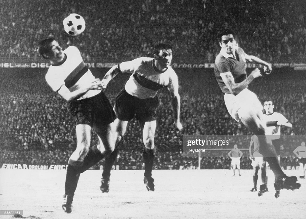 Benefica striker Torres, right, and two Inter Milan defenders heading the ball during the European Cup Final at the San Siro, 27th May 1965. Inter won the match 1-0.