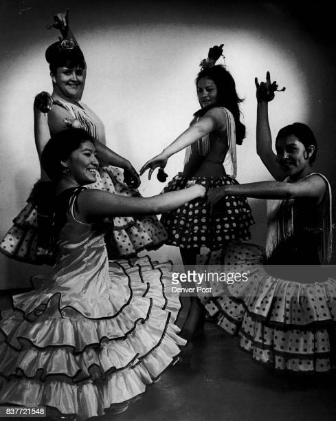 Benefit Dance Scheduled Four Denver girls strike a pose from a Jota Tapatia dance from northern Spain which they will perform Saturday in Craig Colo...