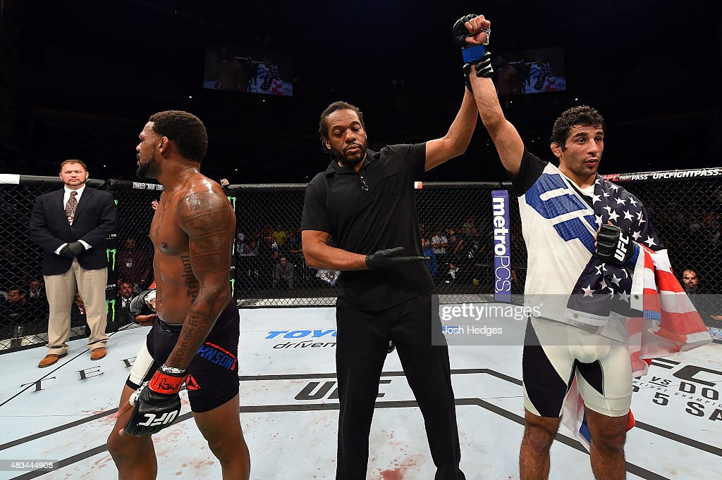 Beneil Dariush celebrates after defeating Michael Johnson in their lightweight bout during the UFC Fight Night event at Bridgestone Arena on August 8, 2015 in Nashville, Tennessee.