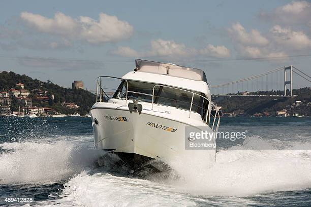 A Beneteau SA motor boat owned by NavetteTezman Holding and operated through the UberBOAT taxi service a unit of Uber Technologies Inc sails past a...