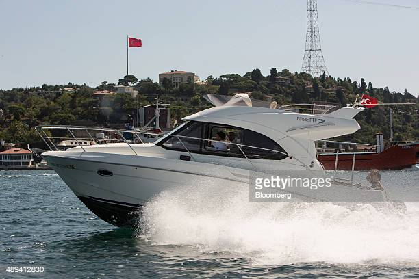 A Beneteau SA motor boat owned by NavetteTezman Holding and operated through the UberBOAT taxi service a unit of Uber Technologies Inc passes a...