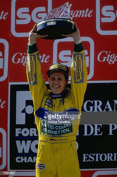 Benetton Ford driver Michael Schumacher of Germany holds the trophy aloft after the Portuguese Grand Prix at the Estoril circuit in Portugal...