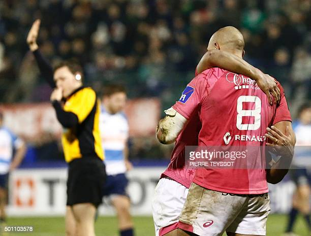 Benetton Treviso's Captain Sergio Parisse celebrates with teammates Will Genia after scoring during the European Rugby Champions Cup match between...