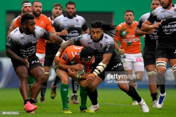 Benetton Treviso's Irish fullback Ian McKinley is tackled by RC Toulon's New Zealander centre Ma'a Nonu and RC Toulon's Fijian winger Josua Tuisova...