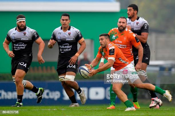Benetton Treviso's Italian scrumhalf Edoardo Gori passes the ball during the European Rugby Champions Cup match Benetton Treviso vs RC Toulon at the...