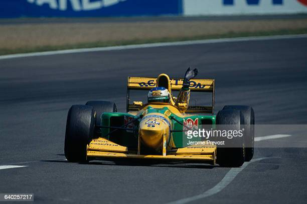 BenettonFord Formula One driver Michael Schumacher raises his arm after winning third place in the 1993 French Grand Prix