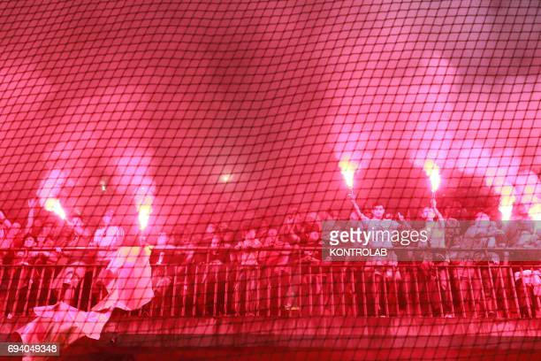 STADIUM BENEVENTO CAMPANIA ITALY Benevento's fans light flares to celebrate the promotion in Serie A the first Italian football league at the end of...