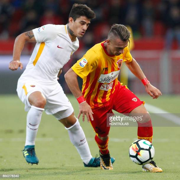 Benevento's Italian defender Gaetano Letizia fights for the ball with Roma's Argentinian midfielder Diego Perotti during the Italian Serie A football...