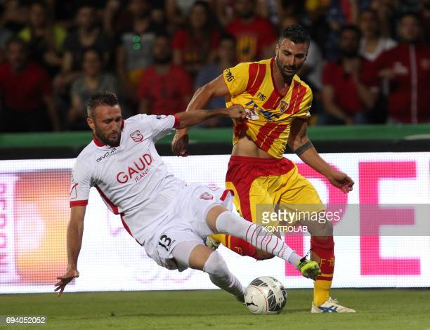 STADIUM BENEVENTO CAMPANIA ITALY Benevento's Italian forward Fabio Ceravolo fights for the ball with Carpi's Italian defender Fabrizio Poli during...