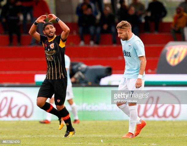 Benevento's Moroccan defender Achraf Lazaar celebrates after scoring next to Lazio's forward from Italy Ciro Immobile during the Italian Serie a...