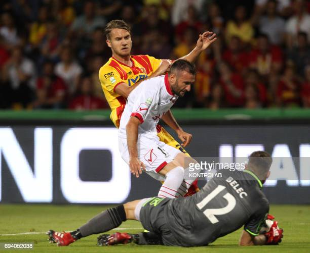 STADIUM BENEVENTO CAMPANIA ITALY Benevento's Romanian forward George Puscas fights for the ball with Carpi's Italian defender Fabrizio Poli and...