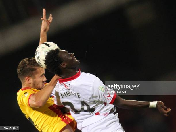 STADIUM BENEVENTO CAMPANIA ITALY Benevento's Romanian forward George Puscas fights for the ball with Carpi's Senegalese midfielder Maodo Malick Mbaye...