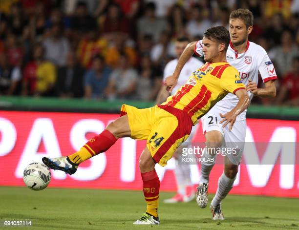 STADIUM BENEVENTO CAMPANIA ITALY Benevento's Romanian forward George Puscas fights for the ball with Carpi's Italian defender Simone Romagnoli during...