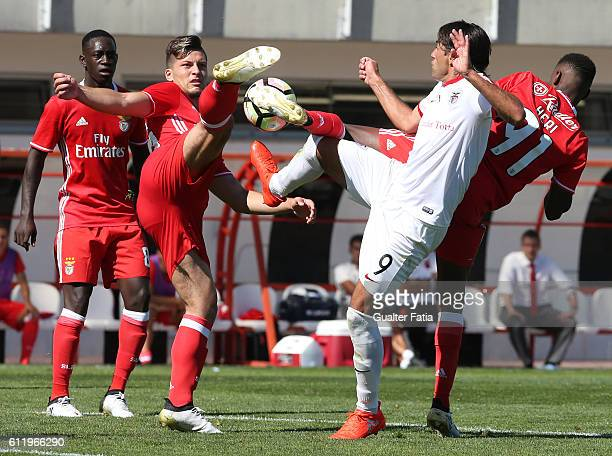Benfica B's forward Luka Jovic and SL Benfica B's forward Heri with Santa Clara's forward Clemente in action during the Segunda Liga match between SL...