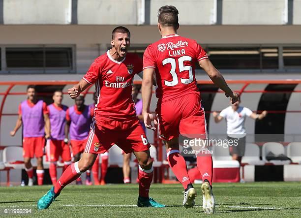 Benfica B's forward Luka Jovic celebrates with teammate SL Benfica B's defender Ruben Dias after scoring a goal during the Segunda Liga match between...