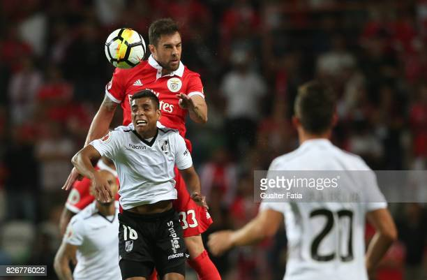 Benfica defender Jardel Vieira from Brasil with Vitoria Guimaraes forward Paolo Hurtado from Peru in action during the SuperTaca match between SL...
