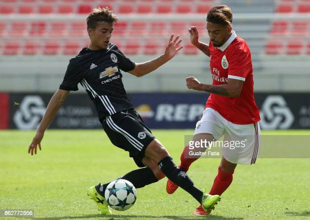 Benfica defender Ricardo Araujo with Manchester United FC midfielder Ethan Hamilton in action during the UEFA Youth League match between SL Benfica...