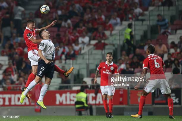 Benfica defender Ruben Dias from Portugal with CD Feirense forward Joao Silva from Portugal in action during the Primeira Liga match between SL...