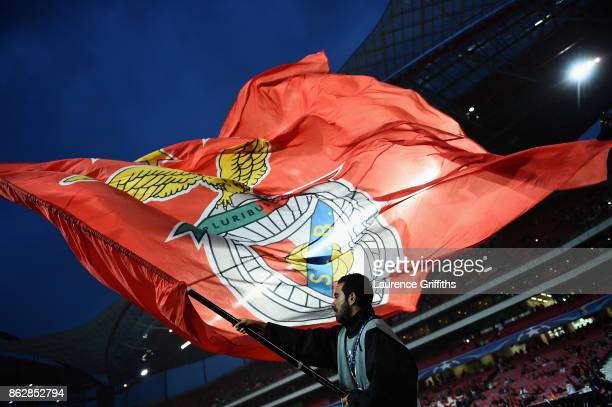 Benfica fan waves a flag prior to the UEFA Champions League group A match between SL Benfica and Manchester United at Estadio da Luz on October 18...