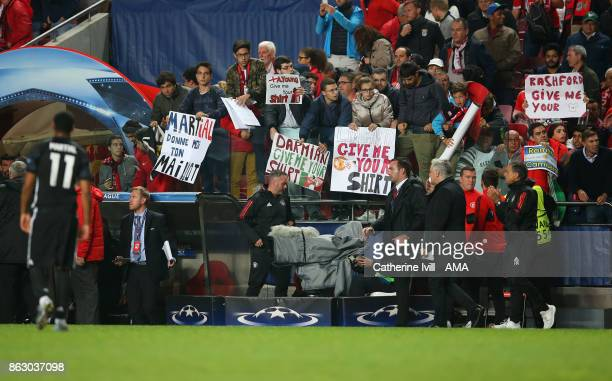 Benfica fans hold up home made signs asking for players shirts after the UEFA Champions League group A match between SL Benfica and Manchester United...